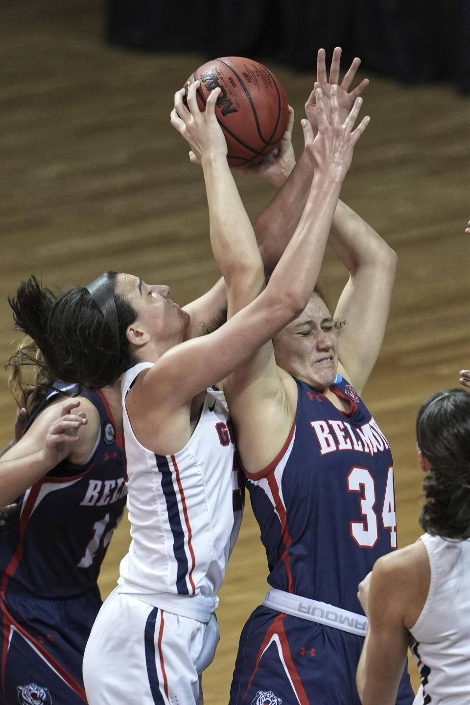 Belmont's Cam Browning (34) and Gonzaga's Jenn Wirth (3) reach for a rebound during the second half of a college basketball game in the first round of the NCAA women's tournament at University Events Center in San Marcos, Texas, Monday, March 22, 2021. (AP Photo/Chuck Burton)