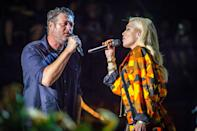 <p>Newlyweds Blake Shelton & Gwen Stefani perform a duet together at the Country Thunder Music Festival in Twin Lakes, Wisconsin on July 18. </p>