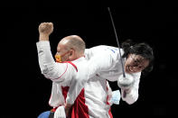 Sun Yiwen of China, left, celebrates with her coach Hugues Obry after winning the women's individual Epee final at the 2020 Summer Olympics, Saturday, July 24, 2021, in Chiba, Japan. (AP Photo/Andrew Medichini)