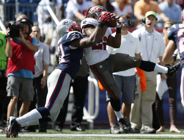 Tampa Bay Buccaneers running back Doug Martin (22) catches a pass in front of New England Patriots outside linebacker Jerod Mayo (51) in the first half of an NFL football game Sunday, Sept. 22, 2013, in Foxborough, Mass. (AP Photo/Elise Amendola)
