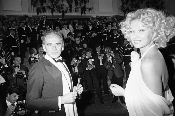 """FILE - In this May 19, 1979 file photo, French fashion designer Pierre Cardin and escort arrive at the Cannes Festival Palace to see Coppola's """"Apocalyplse Now,"""" in Cannes, southern France. France's Academy of Fine Arts says Pierre Cardin, the French designer whose Space Age style was among the iconic looks of 20th-century fashion, has died at 98. (AP Photo/Jean-Jacques Levy, File)"""