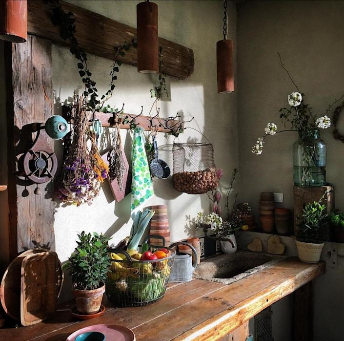 Rustic elements like aged wood and small statement pieces like dried flowers are cornerstones of the cozy cottagecore aesthetic.