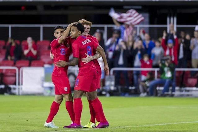 Weston Mckennie of the United States celebrates with Cristian Roldan and Josh Sargent in the first half of a 7-0 victory over Cuba in the 2019 CONCACAF Nations League in Washington (AFP Photo/Scott Taetsch)