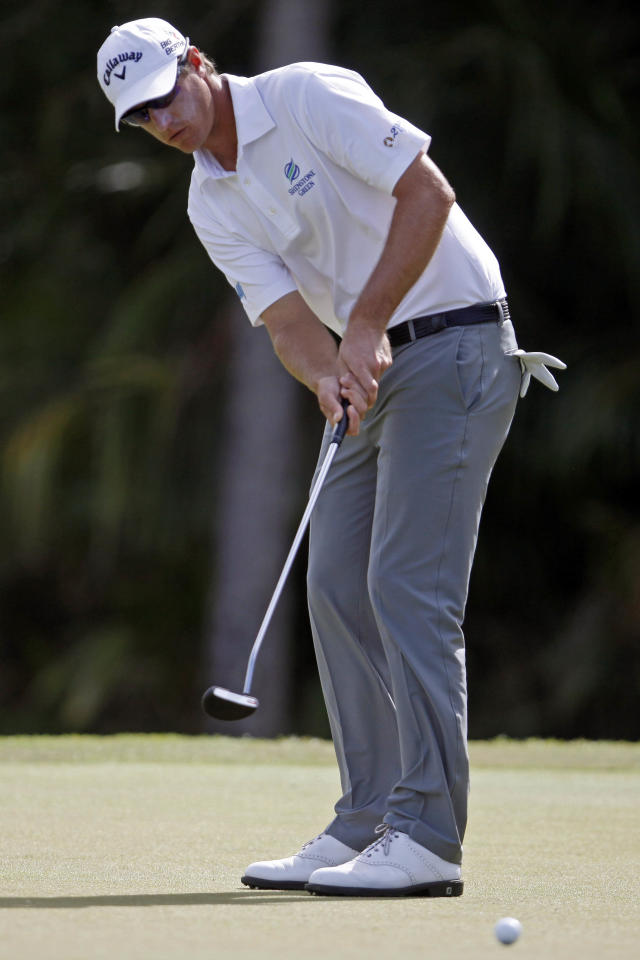 Belgium's Nicolas Colsaerts putts in the 12th hole green during the second round of the Puerto Rico Open PGA golf tournament in Rio Grande, Puerto Rico, Friday, March 7, 2014. (AP Photo/Ricardo Arduengo)