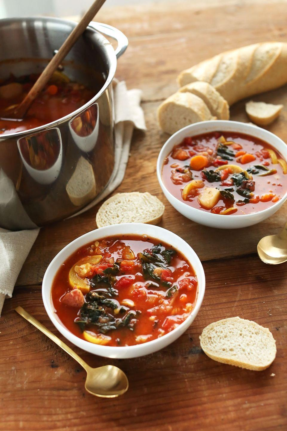 """<p>Thwart tradition and throw together a soup instead—the warm, cozy dish always goes over well on a crisp fall day.</p><p><strong>Get the recipe at <a href=""""https://minimalistbaker.com/tomato-and-vegetable-white-bean-soup/"""" rel=""""nofollow noopener"""" target=""""_blank"""" data-ylk=""""slk:Minimalist Baker"""" class=""""link rapid-noclick-resp"""">Minimalist Baker</a>.</strong> </p>"""