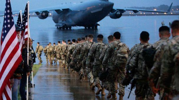 PHOTO: U.S. Army's 82nd Airborne paratroopers march to board a civilian aircraft bound for the U.S. Central Command area of operations from Fort Bragg, N.C., Jan. 4, 2020. (U.S. Department of Defense/AFP via Getty Images)