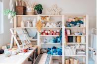 "<p>If you do some weaving, knitting, or needlepoint work in addition to sewing, this tip will also apply to your workshop: Keep all your things easy to access with a modular wall shelving unit. Artist Lindsey Campbell, who runs the weaving-centric blog <a href=""https://www.hellohydrangea.com/"" rel=""nofollow noopener"" target=""_blank"" data-ylk=""slk:Hello Hydrangea"" class=""link rapid-noclick-resp"">Hello Hydrangea</a>, keeps her crafting materials (yarn, rope, winders, and more) on display with an open bookshelf. Glass jars host remnants for recycling and baskets assist with organization. </p>"