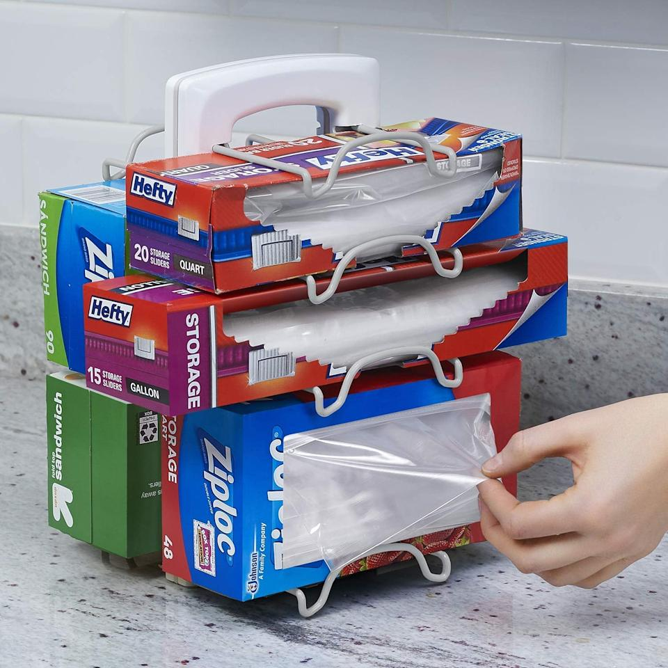"""<p>Clean up the boxes with this <a href=""""https://www.popsugar.com/buy/YouCopia-StoreMore-Adjustable-WrapStand-Kitchen-Wrap-Organizer-460072?p_name=YouCopia%20StoreMore%20Adjustable%20WrapStand%20Kitchen%20Wrap%20Organizer&retailer=amazon.com&pid=460072&price=17&evar1=casa%3Aus&evar9=46697047&evar98=https%3A%2F%2Fwww.popsugar.com%2Fhome%2Fphoto-gallery%2F46697047%2Fimage%2F46700068%2FYouCopia-StoreMore-Adjustable-WrapStand-Kitchen-Wrap-Organizer&list1=shopping%2Corganization%2Ckitchens%2Chome%20organization&prop13=api&pdata=1"""" rel=""""nofollow"""" data-shoppable-link=""""1"""" target=""""_blank"""" class=""""ga-track"""" data-ga-category=""""Related"""" data-ga-label=""""https://www.amazon.com/YouCopia-StoreMore-Adjustable-WrapStand-Organizer/dp/B01CP4CXI0/ref=sr_1_52?crid=SAM9LUJ8PF0&amp;keywords=home+organization+and+storage&amp;qid=1560790986&amp;s=gateway&amp;sprefix=home+or%2Caps%2C223&amp;sr=8-52"""" data-ga-action=""""In-Line Links"""">YouCopia StoreMore Adjustable WrapStand Kitchen Wrap Organizer</a> ($17).</p>"""