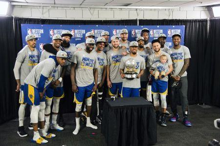 May 20, 2019; Portland, OR, USA; The Golden State Warriors get together for a team photo after defeating the Portland Trail Blazers in game four of the Western conference finals of the 2019 NBA Playoffs at Moda Center. The Warriors won 119-117 in overtime. Mandatory Credit: Troy Wayrynen-USA TODAY Sports