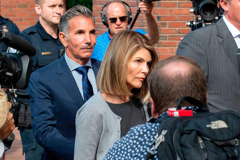 Lori Loughlin and husband Mossimo Giannulli exit the federal courthouse in Boston on Aug. 27, 2019.