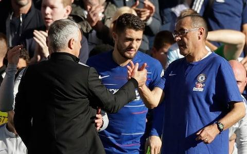 Jose Mourinho and Chelsea's manager Maurizio Sarri, right, shake hands after the 2-2 draw in their English Premier League - Credit: AP