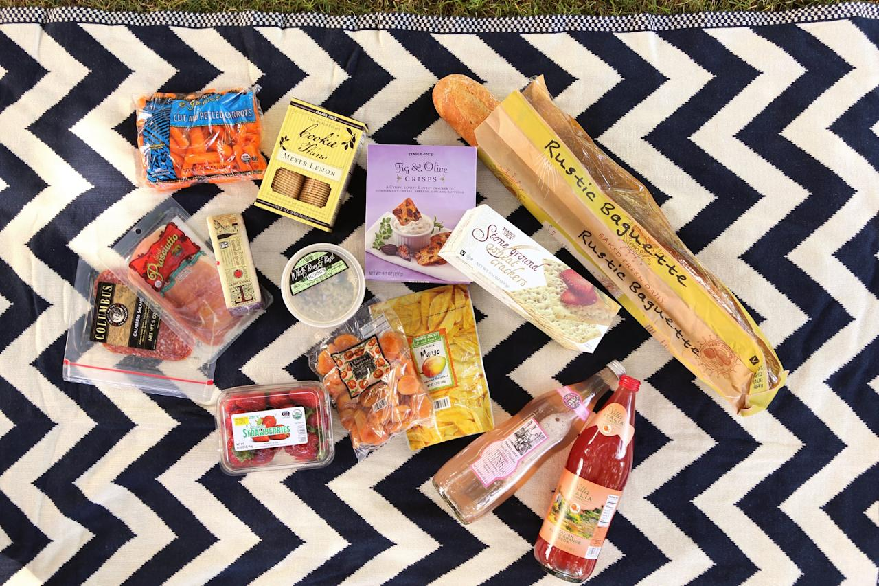 "<p>Here's the full Trader Joe's picnic grocery list:</p> <ul> <li>Organic Strawberries ($4)</li> <li>Organic Baby Carrots ($1)</li> <li>White Bean and Basil Hummus ($4)</li> <li>Prosciutto ($4)</li> <li>Salami ($3)</li> <li>Creamy <span class=""nofilter"">Toscano</span> Cheese Soaked in Syrah ($6)</li> <li>Rustic Baguette ($3)</li> <li>Freeze-Dried Mangoes ($3)</li> <li>Dried Apricots ($4)</li> <li>Fig &amp; Olive Crackers ($4)</li> <li>Stone Ground Wheat Crackers ($2)</li> <li>Meyer Lemon Cookie Thins ($4)</li> <li>Sparkling Pink Lemonade ($3)</li> <li>Italian Sparkling Blood Orange Soda ($3)</li> <li><strong>Optional:</strong> Alcohol!</li> </ul>"