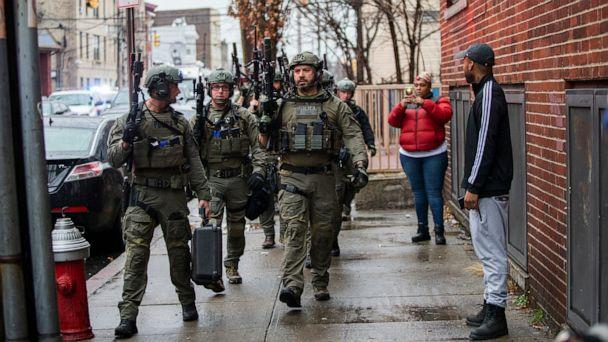 PHOTO: Police officers arrive at the scene following reports of gunfire, Tuesday, Dec. 10, 2019, in Jersey City, N.J. (Eduardo Munoz Alvarez/AP)
