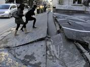 A pedestrian road has collapsed in the massive 8.9-magnitude earthquake in Urayasu city, Chiba prefecture on March 11, 2011. The earthquake shook Japan, unleashing powerful tsunamis that sent ships crashing into the shore and carried cars through the streets of coastal towns. AFP PHOTO / TOSHIFUMI KITAMURA