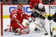 Detroit Red Wings goaltender Jonathan Bernier (45) stops a Boston Bruins left wing Brad Marchand (63) shot in the third period of an NHL hockey game Sunday, Feb. 9, 2020, in Detroit. (AP Photo/Paul Sancya)