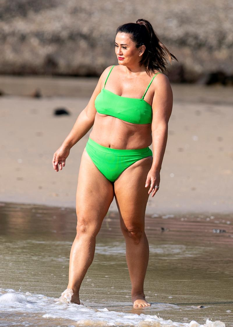 MAFS bride Mishel Meshes cools off in the Sydney heat by taking a dip in a lime green bikini. Photo: DIIMEX.