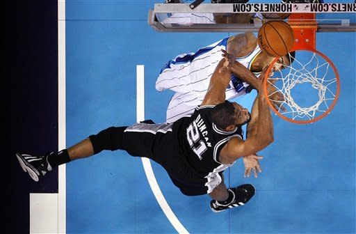 San Antonio Spurs power forward Tim Duncan (21) drives to the basket against New Orleans Hornets power forward Anthony Davis in the first half of an NBA basketball game in New Orleans, Wednesday, Oct. 31, 2012. (AP Photo/Gerald Herbert)