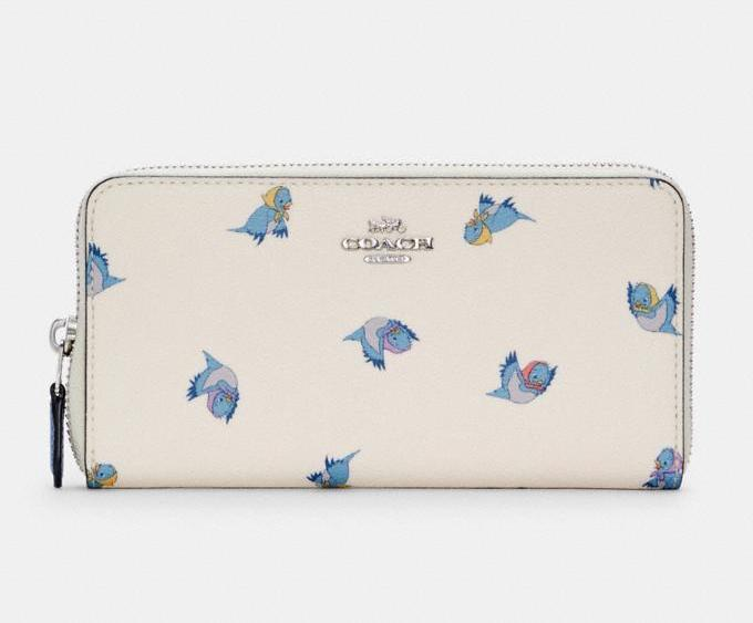 Disney X Coach Accordion Zip Wallet With Cinderella Flying Birds Print. Image via Coach Outlet.
