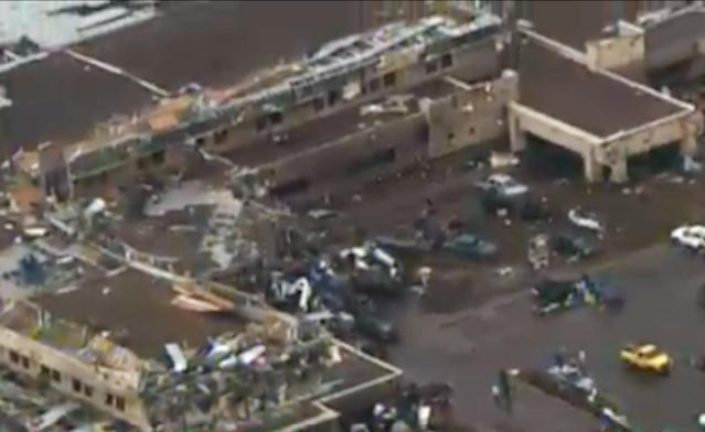 This frame grab courtesy of KFOR TV shows the aftermath of a massive tornado as much as a mile wide with winds up to 200 mph roared through the Oklahoma City suburbs Monday, May 20, 2013. (AP Photo/Courtesy KFOR TV)