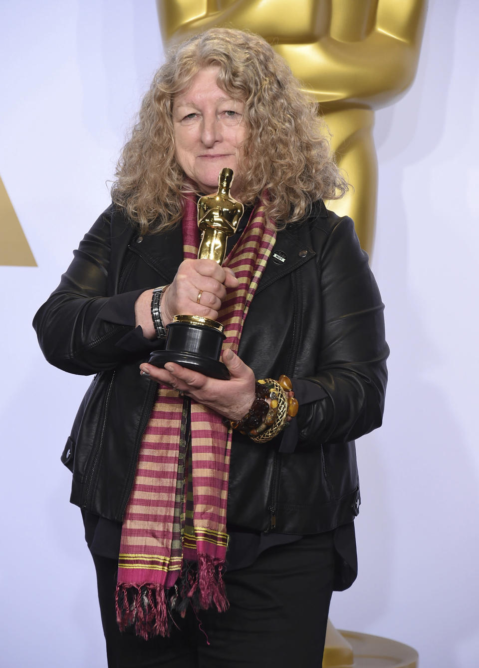 """FILE - Jenny Beavan poses with the award for best costume design for """"Mad Max: Fury Road"""" at the Oscars in Los Angeles on Feb. 28, 2016. Beavan designed the costumes for the film """"Cruella."""" (Photo by Jordan Strauss/Invision/AP, File)"""