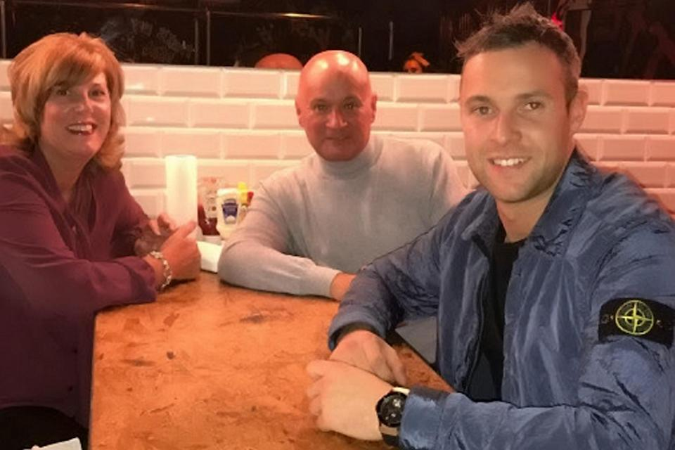 Jamie Harron pictures with his parents Graham and Patricia (SWNS)