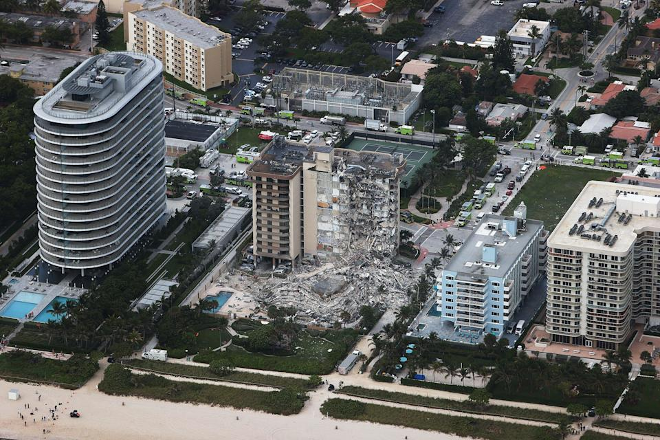 11 people were confirmed dead on Monday following the fall which appeared to affect one leg of the L-shaped tower on June 24 (Getty Images)