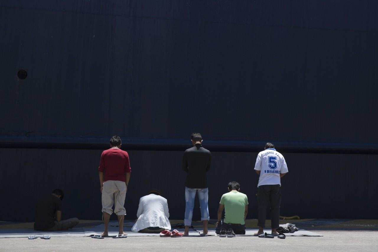 <p>Afghan migrants stranded in Greece, pray in front of a docked ferry at the port of Piraeus, near Athens, on the first day of Ramadan, June 6, 2016. (AP/Petros Giannakouris) </p>