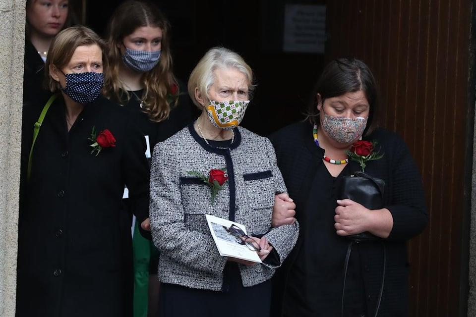 Pat Hume, centre, at the funeral of her husband John in Derry in 2020 (PA) (PA Archive)