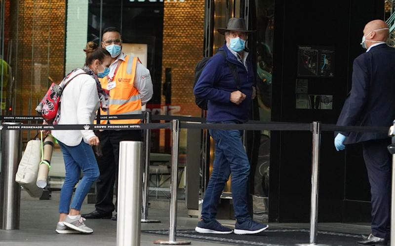 Photo shows returned travellers entering hotel quarantine in Melbourne.