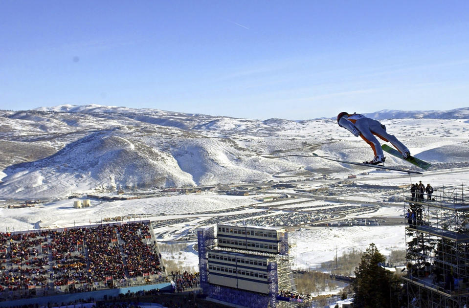 FILE - In this Feb. 10, 2002, file photo, Simon Ammann, of Switzerland, competes in the men's K90 individual ski jump at the Salt Lake City Winter Olympics in Park City, Utah. Leaders of a new Salt Lake City Olympic bid committee vowed Wednesday, Feb. 26, 2020, to be transparent and frugal as they design a plan based around existing venues and experience from hosting the 2002 Winter Olympics but that will also include new, modern ideas. (AP Photo/Elise Amendola, File)