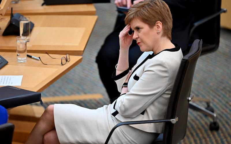 Nicola Sturgeon's government has been accused of sending mixed messages to students - Getty Images Europe