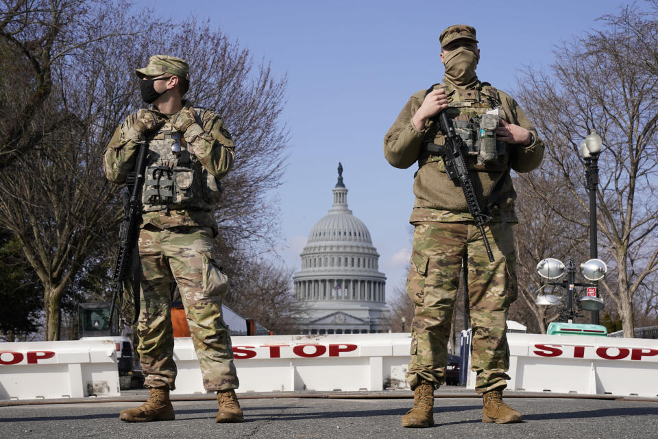 """National Guard keep watch on the Capitol, Thursday, March 4, 2021, on Capitol Hill in Washington. Capitol Police say they have uncovered intelligence of a """"possible plot"""" by a militia group to breach the U.S. Capitol on Thursday, nearly two months after a mob of supporters of then-President Donald Trump stormed the iconic building to try to stop Congress from certifying now-President Joe Biden's victory. (AP Photo/Jacquelyn Martin)"""