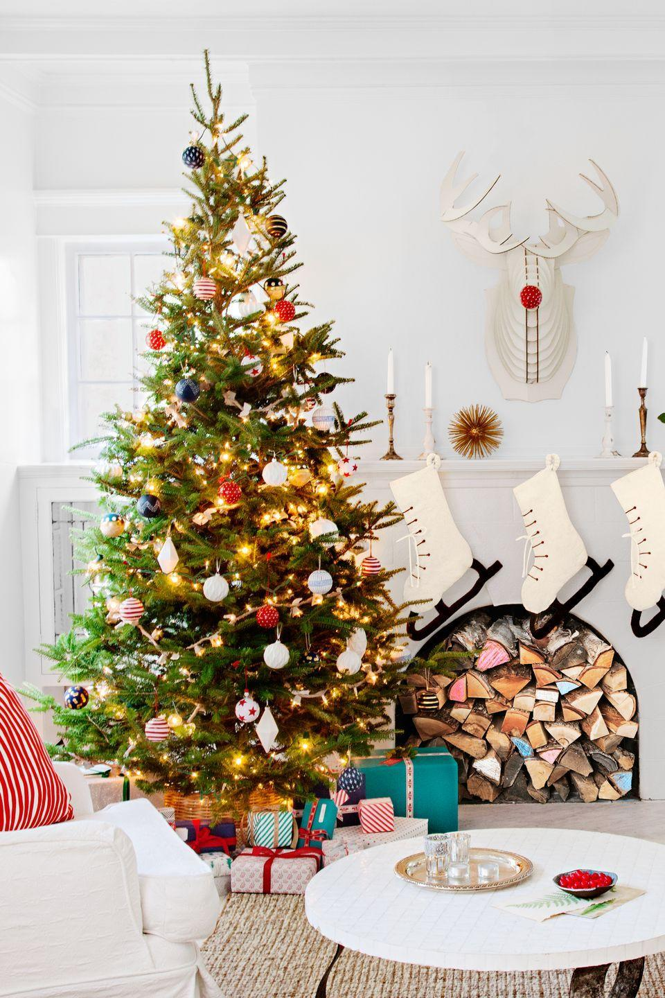 """<p>For a frosty finish, hang ice-skate stockings; their nubby white felt complements other neutral textures in the room such as the slip-covered sofa.</p><p><a class=""""link rapid-noclick-resp"""" href=""""https://go.redirectingat.com?id=74968X1596630&url=https%3A%2F%2Fwww.wayfair.com%2Fholiday-decor%2Fpdp%2Farcadia-home-hand-felted-wool-ice-skate-stocking-acad1211.html&sref=https%3A%2F%2Fwww.countryliving.com%2Fshopping%2Fg1407%2Fpersonalized-christmas-stockings%2F"""" rel=""""nofollow noopener"""" target=""""_blank"""" data-ylk=""""slk:SHOP ICE-SKATE STOCKINGS"""">SHOP ICE-SKATE STOCKINGS</a></p>"""