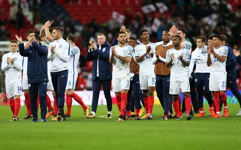 England's players trudge off the pitch at the end of their dire 1-0 win over Slovenia - Action Plus