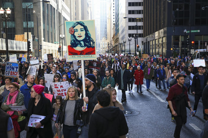 <p>Protesters walk along North LaSalle Street during the Women's March on Chicago the day after President Donald Trump's inauguration Saturday, Jan. 21, 2017 in Chicago. (Armando L. Sanchez/Chicago Tribune via AP) </p>