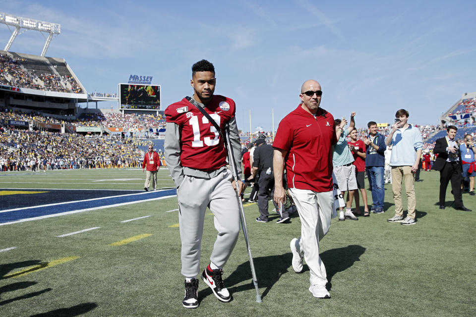 ORLANDO, FL - JANUARY 01: Injured quarterback Tua Tagovailoa #13 of the Alabama Crimson Tide leaves the field following warmups prior to the Vrbo Citrus Bowl against the Michigan Wolverines at Camping World Stadium on January 1, 2020 in Orlando, Florida. Alabama defeated Michigan 35-16. (Photo by Joe Robbins/Getty Images)