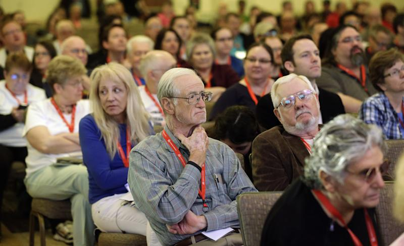 People look on as David Silverman, president of the American Atheists, addresses the American Atheists National Convention in Salt Lake City on Friday, April 18, 2014. In an effort to raise awareness and attract new members, the organization is holding their national conference over Easter weekend in the home of The Church of Jesus Christ of Latter-day Saints. (AP Photo/Rick Bowmer)
