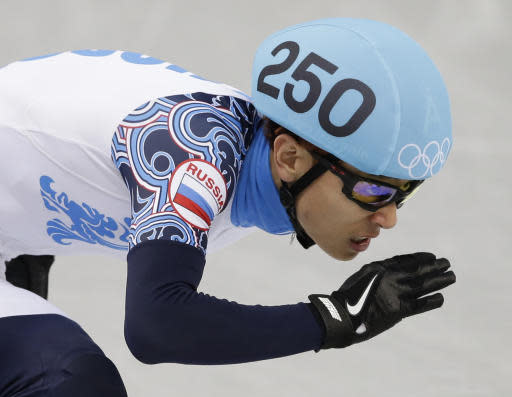 Victor An of Russia competes in a men's 500m short track speedskating heat at the Iceberg Skating Palace during the 2014 Winter Olympics, Tuesday, Feb. 18, 2014, in Sochi, Russia. (AP Photo/Darron Cummings)