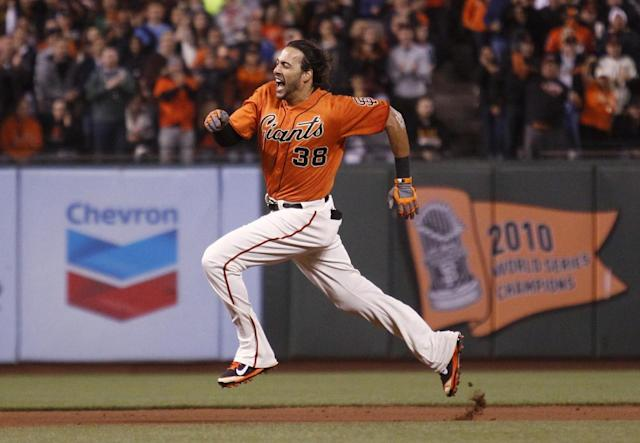 San Francisco Giants' Michael Morse runs to third for an extra base on a Colorado Rockies error after hitting an RBI double during the fifth inning of a baseball game in San Francisco, Friday, June 13, 2014. (AP Photo/Beck Diefenbach)
