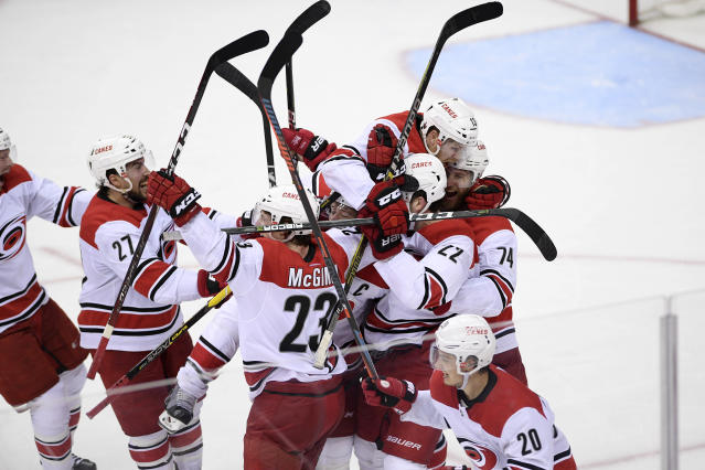 The Carolina Hurricanes celebrate after Game 7 of an NHL hockey first-round playoff series against the Washington Capitals, Wednesday, April 24, 2019, in Washington. The Hurricanes won 4-3 in double overtime. (AP Photo/Nick Wass)