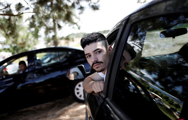 FILE PHOTO: Uber drivers sit in their cars as they wait for passengers in Sao Paulo