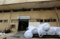 A man is pictured at Sleep Comfort furniture factory that was damaged during Beirut port blast