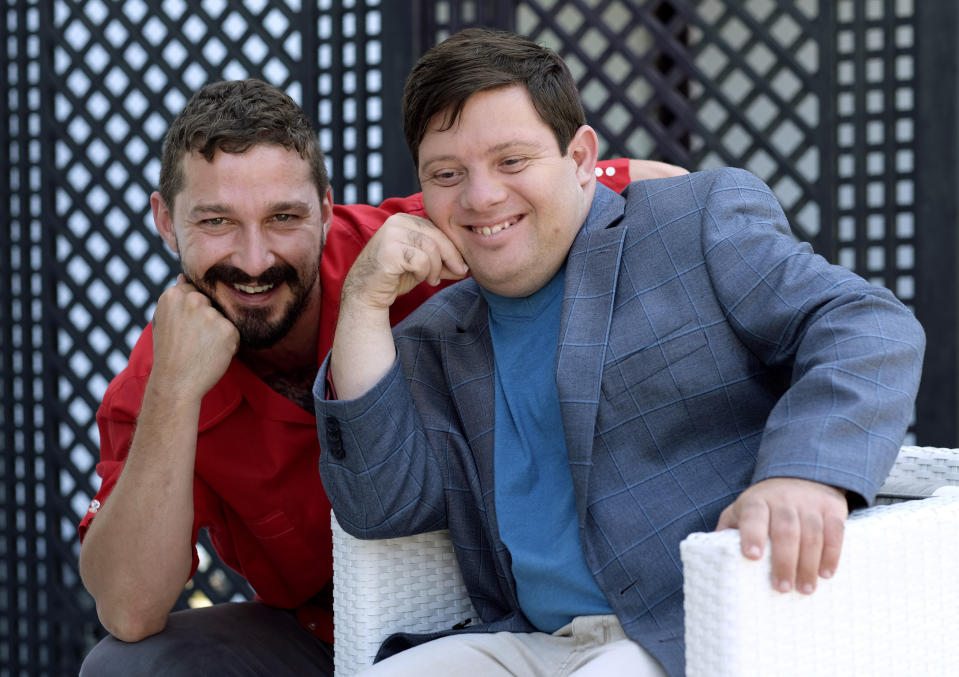 """In this Friday, Aug. 2, 2019 photo, Shia LaBeouf, left, and Zack Gottsagen, cast members in the film """"The Peanut Butter Falcon,"""" pose together for a portrait at the London West Hollywood, in West Hollywood, Calif. The movie opens in the U.S. on Aug. 9. (Photo by Chris Pizzello/Invision/AP)"""