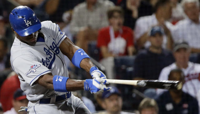 Los Angeles Dodgers' Yasiel Puig hits a single against the Atlanta Braves in the second inning of Game 1 of the National League Division Series, Thursday, Oct. 3, 2013, in Atlanta. (AP Photo/John Bazemore)