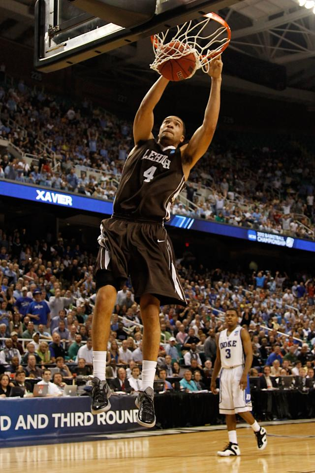 GREENSBORO, NC - MARCH 16:  John Adams #4 of the Lehigh Mountain Hawks dunks the ball late in the second half against the Duke Blue Devils during the second round of the 2012 NCAA Men's Basketball Tournament at Greensboro Coliseum on March 16, 2012 in Greensboro, North Carolina.  (Photo by Mike Ehrmann/Getty Images)