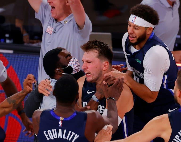 Doncic nails epic buzzer-beater as Celtics, Raptors set up clash