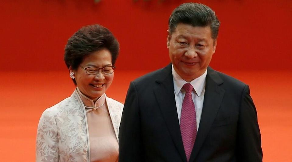 Carrie Lam had to present her annual work report to President Xi Jinping by videoconference last week. Photo: Reuters