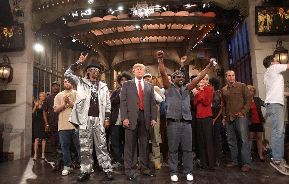 """SATURDAY NIGHT LIVE -- Episode 16 -- Air Date 04/03/2004 -- Pictured: (l-r) Bootsy Collins, Donald Trump and Frederick """"Toots"""" Hibbert of Toots and the Maytals on April 3, 2004 (Photo by Mary Ellen Matthews/NBCU Photo Bank/NBCUniversal via Getty Images via Getty Images)"""