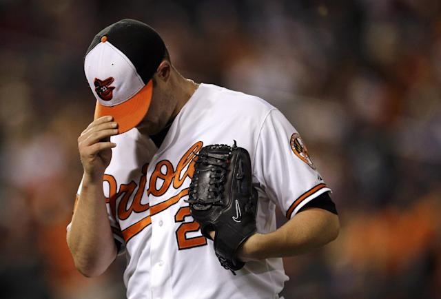 Baltimore Orioles starting pitcher Bud Norris adjusts his cap as he walks off the field after the top of the third inning of a baseball game against the Toronto Blue Jays, Wednesday, Sept. 25, 2013, in Baltimore. Norris allowed two runs in the third. (AP Photo/Patrick Semansky)