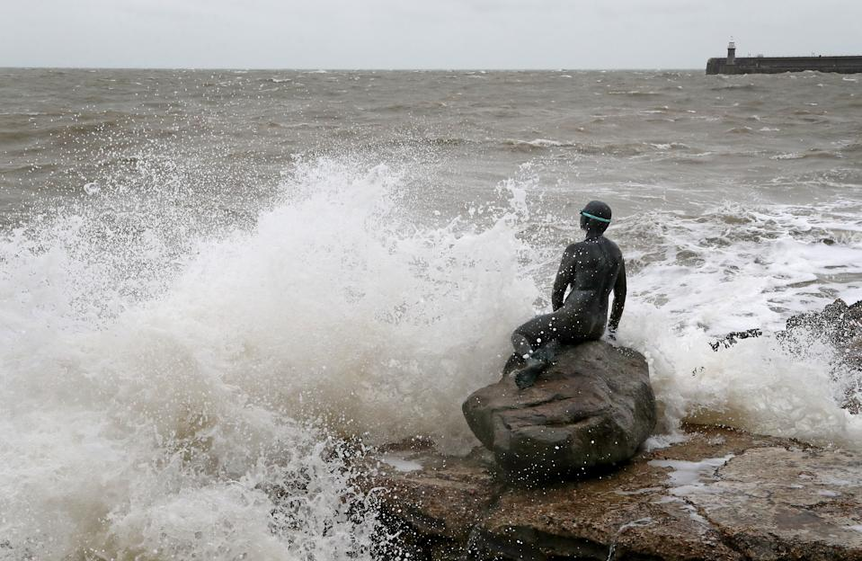 Waves hit the Folkestone Mermaid statue in Folkestone, Kent. Parts of the UK are preparing to be lashed by heavy rain and high winds as Storm Alex heralds the arrival of a stretch of bad weather over the weekend.